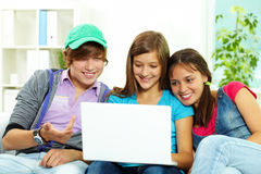 Studying teens. Three teenagers studying with computer Royalty Free Stock Images