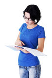 Studying thoughtful young woman. Royalty Free Stock Images