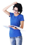 Studying thoughtful young woman. Stock Image
