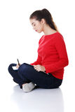 Studying thoughtful young woman reading notebook. Royalty Free Stock Photography