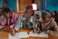 Studying to grow and grow to study 07. 25 October 2017-Franciscan Center of Pomerini-Tanzania, Africa-A group of unidentified African children follow the after Stock Photos
