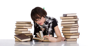 Studying between two pile of books Stock Photography