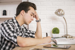 Studying young man sideview Stock Images