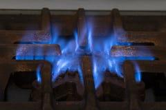 Stufa con la fiamma blu Illustrazione del consumo del gas Aumento di tasso e di crisi in Argentina fotografia stock libera da diritti