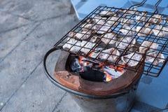 Stufa di calore dell'ustione secca calamaro arrostito Fotografia Stock