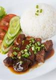 Stufato tailandese del porco con riso cotto a vapore Immagine Stock