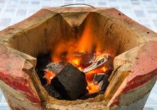 Stufe e fuoco del carbone Fotografia Stock Libera da Diritti