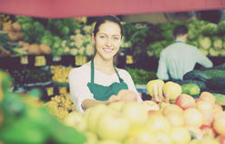 Stuff in apron selling apples Royalty Free Stock Photos