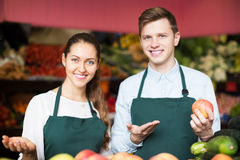 Stuff in apron selling apples Royalty Free Stock Images