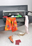 Stuff and clothes suitcase scattered in a sofa Stock Photo