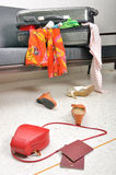 Stuff and clothes travel suitcase scattered in sofa Stock Photo