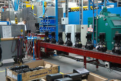 Stuff at conveyor with fabricated pumps on a plant Royalty Free Stock Photos