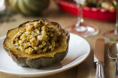 Stuffed Acorn Squash on set table Royalty Free Stock Photography
