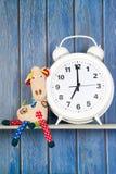 Stuffed animal giraffe and clock for bedtime Stock Image