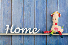 Stuffed animal giraffe at home Stock Photos