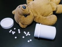 Medication and children, bear with pills 2 royalty free stock image