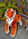Stuffed animal tiger toy in garden Stock Photos