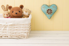 Stuffed animal toys in a basket Stock Photos