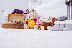 Stuffed animal toys in interior room Royalty Free Stock Images