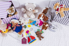 Stuffed animal toys in interior room Royalty Free Stock Photos