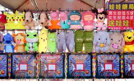 Stuffed Animals and Cartoon Characters. KAOHSIUNG, TAIWAN -- JANUARY 5, 2019: An outdoor skill game stall offers television animation characters merchandise for royalty free stock image