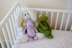Stuffed animals in the crib Stock Photos
