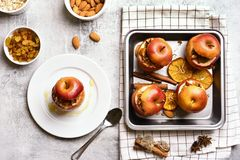 Stuffed apples with granola, cinnamon, nuts Royalty Free Stock Images