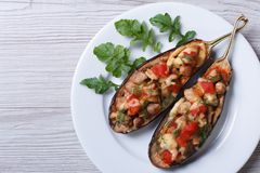 Stuffed aubergine with meat, cheese and tomatoes Royalty Free Stock Photo