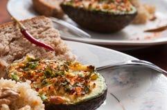 Stuffed avocado plates Stock Photography