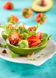 Stuffed avocado  with strawberries  and nut stock photos