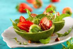 Stuffed avocado  with strawberries  and nut royalty free stock photo