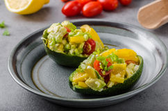 Stuffed avocado with vegetable Royalty Free Stock Images