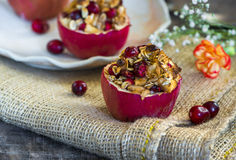 Stuffed baked red apples with granola, cranberries and marzipan Royalty Free Stock Images