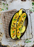 The stuffed, baked zucchinis from a quinoa , bulgury and  feta. Royalty Free Stock Photo