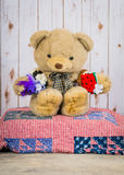 Stuffed bear displays hair bands. Stuffed bear sits with hair bows hanging from his arms on display royalty free stock photography