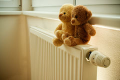Stuffed bears on radiator stock photography