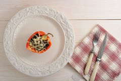 Stuffed bell pepper with meat and cheese on the plate Stock Photos