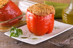 Stuffed bell pepper on white dish. Royalty Free Stock Image
