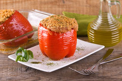 Stuffed bell pepper on white dish. Stock Photos
