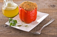 Stuffed bell pepper on white dish. Royalty Free Stock Photo