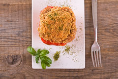 Stuffed bell pepper on white dish. Royalty Free Stock Photography