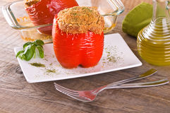 Stuffed bell pepper on white dish. Stock Photo