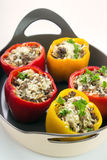Stuffed bell peppers. On ceramic oven dish closeup , vertical Royalty Free Stock Photo