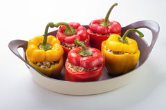 Stuffed bell peppers. With rice, ground beef , onion and cheese on ceramic oven dish Stock Photography