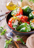 Stuffed bell peppers on rustic wooden background Royalty Free Stock Image