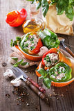 Stuffed bell peppers on rustic wooden background Royalty Free Stock Photo