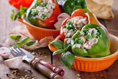 Stuffed bell peppers on rustic wooden background Stock Photography