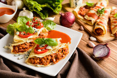 Stuffed Bolognese pancakes with minced meat and vegetable with tomato sauce Royalty Free Stock Photo