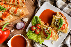 Stuffed Bolognese pancakes with minced meat and vegetable with tomato sauce Royalty Free Stock Photos