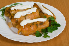 Stuffed cabbage. Under sour cream Royalty Free Stock Photos